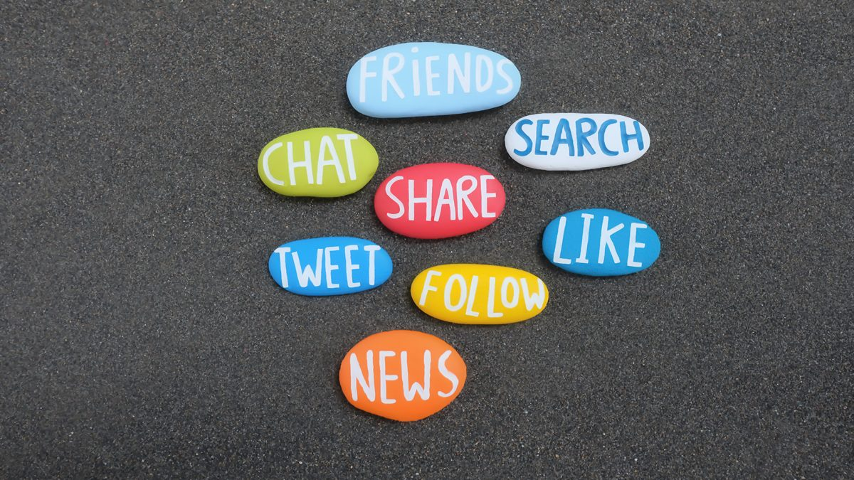 Social Words composed with carved and multi colored stones